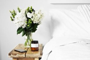 Sleep Phone by bed with flowers